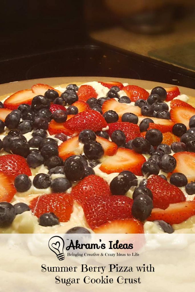 Recipe for an end of summer berry pizza with sugar cookie crust and white chocolate sauce.
