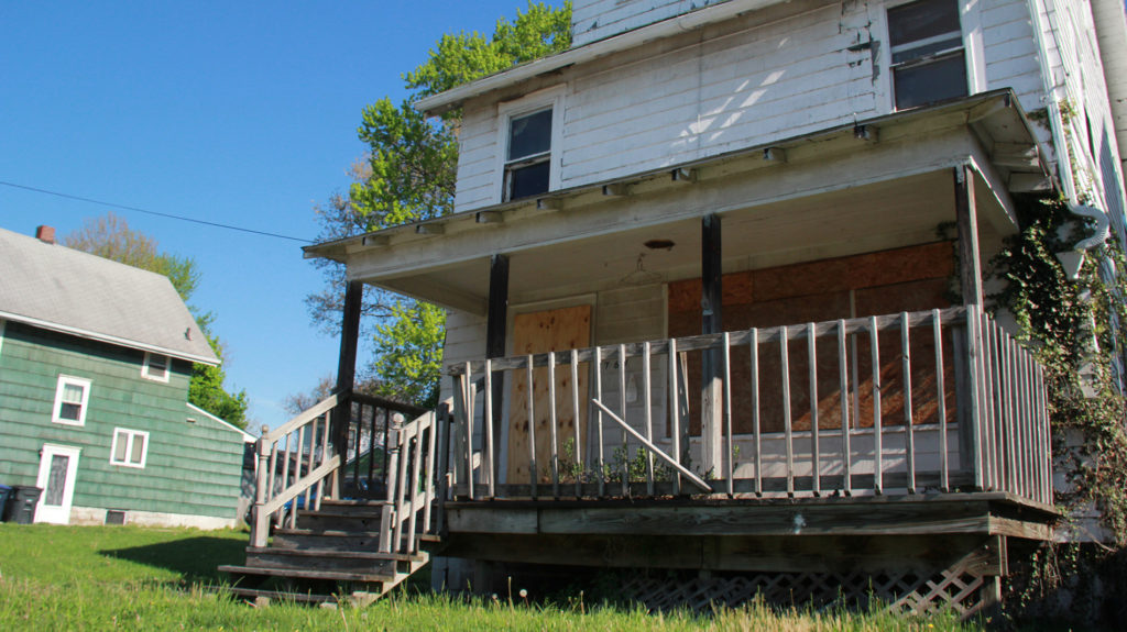 "As part of the Neighborhood Reborn project, some of the vacant houses will get a facelift via an ""artistic board-up"" and others will get a preservation treatment from the East Akron Neighborhood Development Corp. (Photo: Chris Miller)"