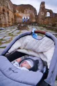35 days old traveler sleeps in his stroller in Prespes