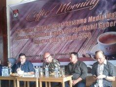 Anggota KPU RI Ilham Saputra dan anggota KPU Sulut (1)