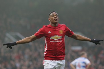 MANCHESTER, ENGLAND - JANUARY 07: Anthony Martial of Manchester United celebrates scoring their second goal during the Emirates FA Cup Third Round match between Manchester United and Reading at Old Trafford on January 7, 2017 in Manchester, England. (Photo by John Peters/Man Utd via Getty Images)