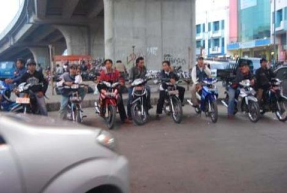 The ojek drivers under the flyover.