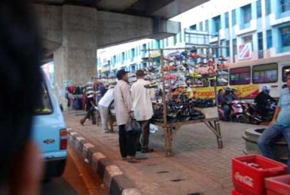The shoe seller who trades under the flyover.