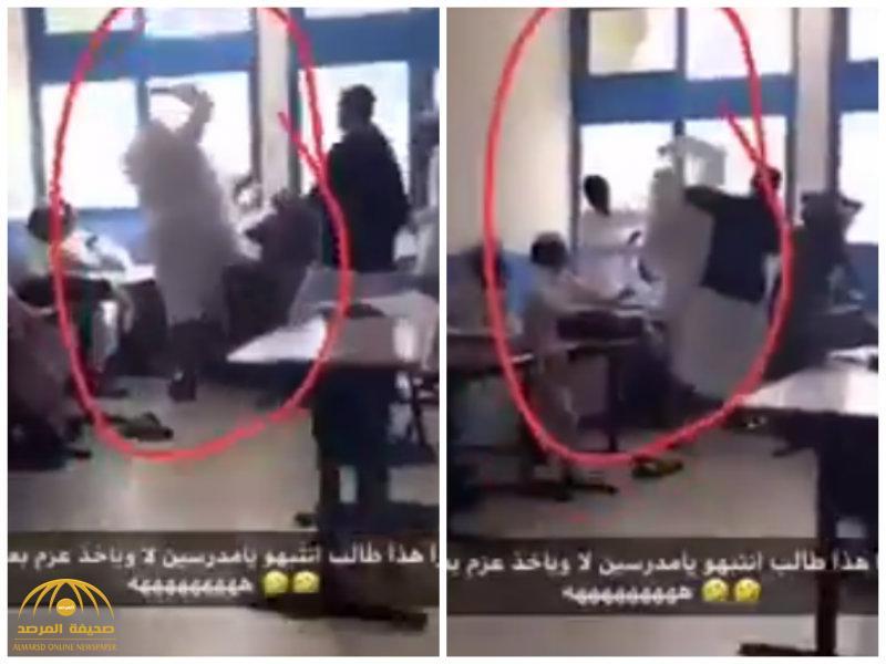 """شاهد .. طالب""""ضخم""""يضرب زميله داخل الفصل"""