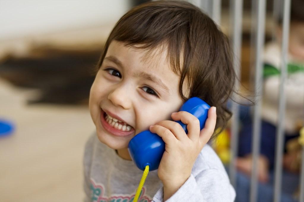 Child using toy phone
