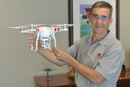 Bill Hutto of the Auburn Aviation Center holds an unmanned aircraft system that will be used in the university's FAA-authorized flight school.