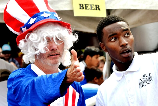 Jason Sullivan, dressed as Uncle Sam, gets direction from event staff at Legion Field Sunday. (Solomon Crenshaw Jr./Alabama NewsCenter)