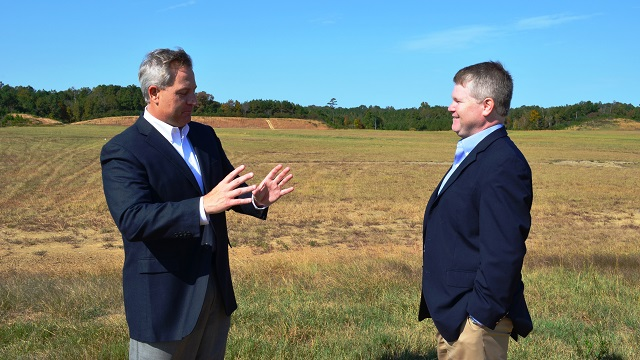 David Knight, executive director of the Walker County Development Authority, left, and Blair King, senior project manager with Alabama Power, stand at the site of the future Yorozu plant in Jasper. (Michael Tomberlin/Alabama NewsCenter)