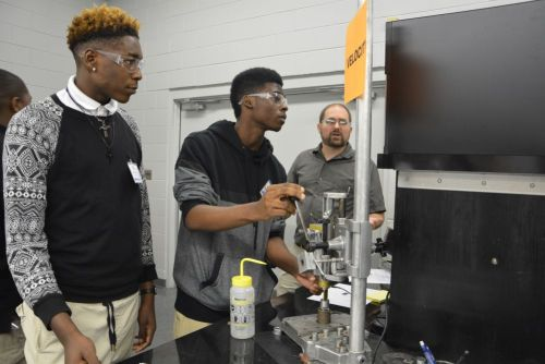 Students from Ramsay High School perform a velocity experiment in a Southern Research engineering lab with Gregory Daspit, mechanical engineer.