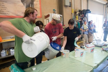 Students and researchers mix the resin to use on the crack. (UAB Media)