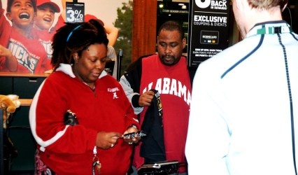 Donta Lyles, left, and Geoffrey Lyles check out with their new gear. (Solomon Crenshaw Jr./Alabama NewsCenter)