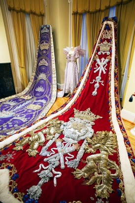 Coronation robes of Mobile Carnival Association royalty, 2003 Queen Virginia Oliver Van Antwerp, left, and 2001 King Felix III Thomas Bragg Van Antwerp Jr. are displayed at the Mobile Carnival Museum. (Mike Kittrell/Alabama NewsCenter)