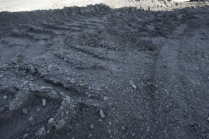Bulldozer makes tracks over coal pile (File)