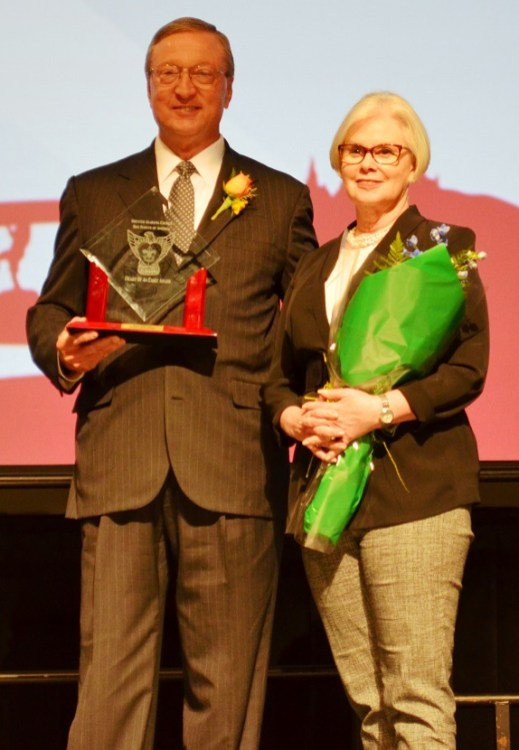 """Fromer Motion Industries CEO Bill Stevens is joined by his wife Kimeran as he receives the """"Heart of the Eagle"""" award. (Michael Tomberlin/Alabama NewsCenter)"""