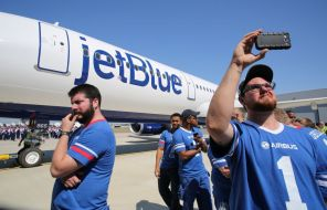 Employee Kevin Powell, right, records the delivery ceremony Monday, April 25 for JetBlue A321 Ð the first Airbus aircraft produced at Airbus U.S. Manufacturing Facility in Mobile, Ala. (Mike Kittrell/Alabama NewsCenter)