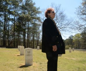 McKinney ponders the fates of German and Italian POWs. (Karim Shamshi-Basha/Alabama NewsCenter)