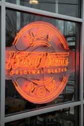 "The ""Hot Now"" sign alerts passersby that a Krispy Kreme shop has freshly made doughnuts ready to buy. (Krispy Kreme)"