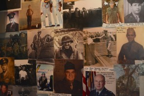 Pictures of American veterans from various wars decorate the wall of Barry Booth's dental office. (Karim Shamsi-Basha)