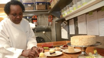 Dolester Miles, head pastry chef for three of Frank Stitt's Birmingham restaurants, with some of the creations that earned her accolades. (Karim Shamsi-Basha / Alabama NewsCenter)