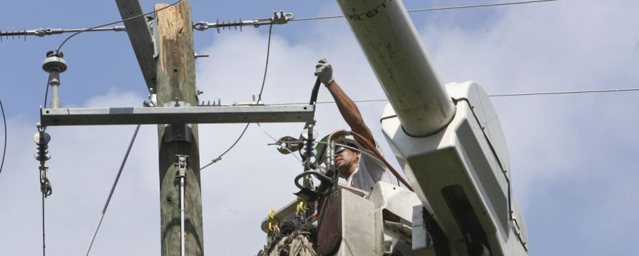 Lineman works to repair poles and cables in Hoover. (file)