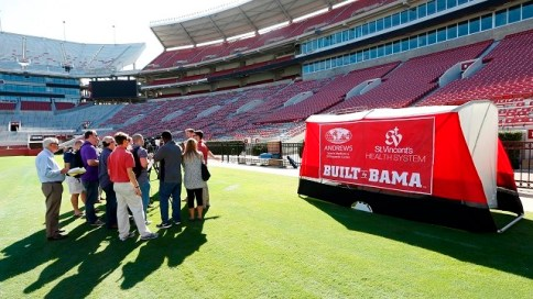 Visitors look over the prototype of the SidelinER medical tent, developed at the University of Alabama. (University of Alabama)
