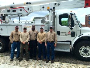 Alabama Power linemen pose in the capital city (Photo courtesy of Alabama Power)