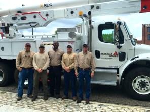 Alabama Power linemen pose in the capital city (Photo courtesy of Alabama Power)