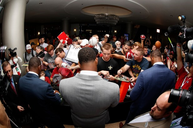 Alabma Crimson Tide players Jonathan Allen, OJ Howard, and Eddie Jackson enter SEC Media Days and sign autographs for fans. (Kent Gidley/UA Athletics)