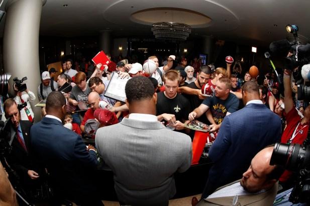 Alabma Crimson Tide players Jonathan Allen, OJ Howard, and Eddie Jackson enter SEC Media Days and sign autographs for fans. (Kent Gidley/UA Athletics)
