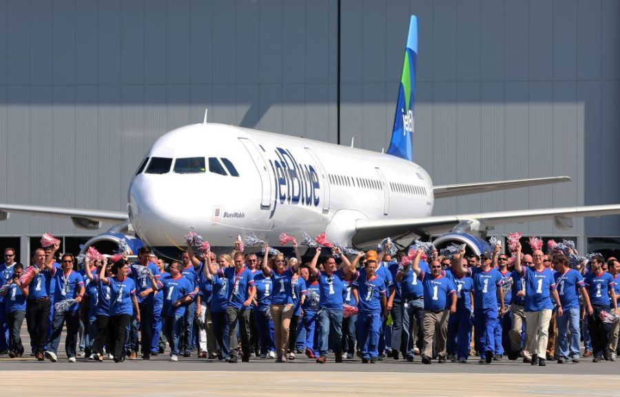 Employees celebrate during the April delivery ceremony for the first Airbus aircraft produced at Airbus U.S. Manufacturing Facility in Mobile. (Mike Kittrell/Alabama NewsCenter)