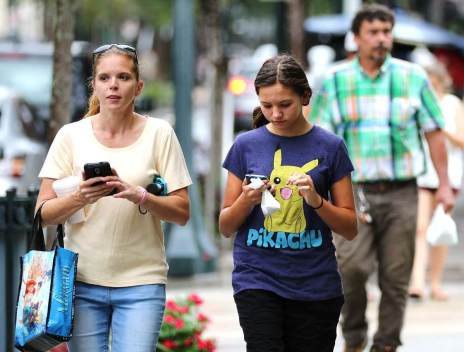 Nickett Kelley of Saraland, left, and daughter Carmen Kelley, 12, play Pokémon Go in Mobile. (Mike Kittrell/Alabama NewsCenter)