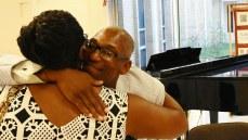 Roderick Royal hugs a fan at a book signing. (Solomon Crenshaw Jr./Alabama NewsCenter)