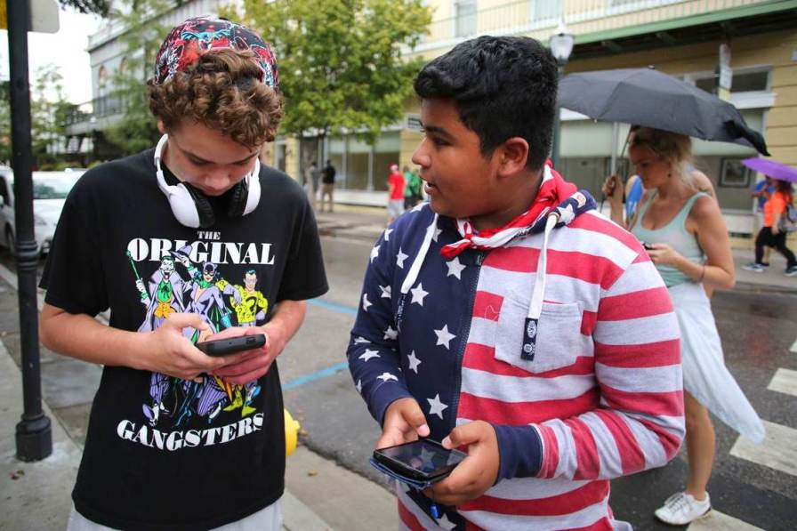 Shawn Narmore, 13, left, and Ricardo Navarrete, 13, play Pokémon Go in Mobile. (Mike Kittrell/Alabama NewsCenter)