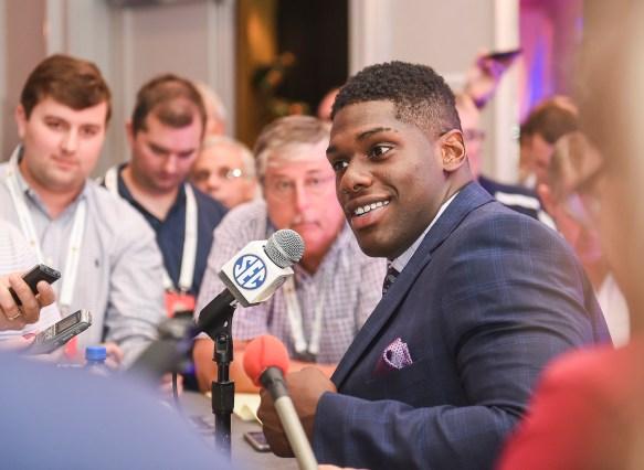 Auburn defensive lineman Carl Lawson speaks during SEC Football Media Days on Monday in Hoover. (Wade Rackley/Auburn Athletics)
