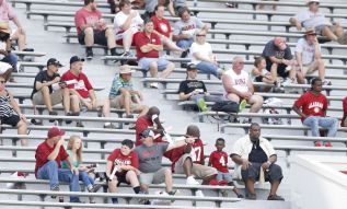 Fans watch practice from the stands prior to Fan Day. (Amelia B. Barton / UA Athletics)