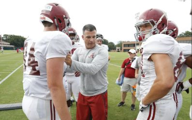 Alabama tackles and tight ends coach Mario Cristobal works with tight ends Hale Hentges (84) and Miller Forristall (87) during the first practice in full pads Monday. (Robert Sutton / UA Athletics)