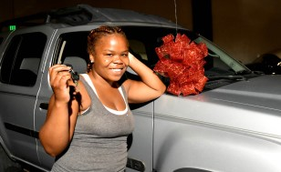 Bianca Donerson holds the keys to the Nissan Xterra she received in the Willie J. Foundation Wheels of Change first giveaway. (Solomon Crenshaw Jr. / Alabama NewsCenter)
