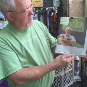 Jimmy Johnson of Dog Days of Birmingham holds an article (Keisa Sharpe/Alabama NewsCenter)