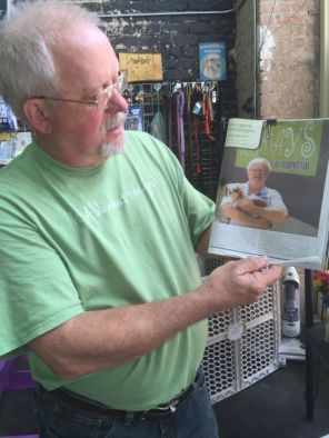 Jimmy Johnson of Dog Days of Birmingham holds an article (Keisa Sharpe/Alabama NewsCenter)