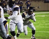 Jamarcus Nance (25) rounds the corner into some open field. (Miles College Football)