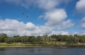 Zip liners cross the Chattahoochee River in Phenix City, Al. (Bernard Troncale/Alabama NewsCenter)