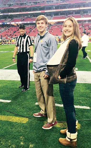 Steve Marlowe with his son Tommy and daughter Grier on the sidelines before the 2016 Fiesta Bowl. (contributed)