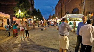 Artwalk takes place on the streets and in the businesses of Birmingham's Morris Avenue and First and Second Avenues North. Some businesses pair with the same artists year after year. (Arik Sokol)