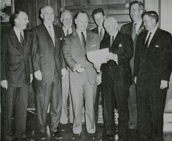 Tom Martin (third from right), chairman of the board of Alabama Power Company, presents Secretary of the Interior Fred Seaton with land deeds for the area encompassing the Horseshoe Bend National Military Park. The land had been owned by Alabama Power. Taken April 24, 1959, the photo shows, from left, Judge C.J. Coley; Congressman Albert Rains; Conrad Wirth, director, National Park Service; Seaton; Ralph Smith Jr., legal adviser to Gov. John Patterson; Martin; Sen. John Sparkman; and Congressman Kenneth Roberts. (Alabama Power Company Archives)