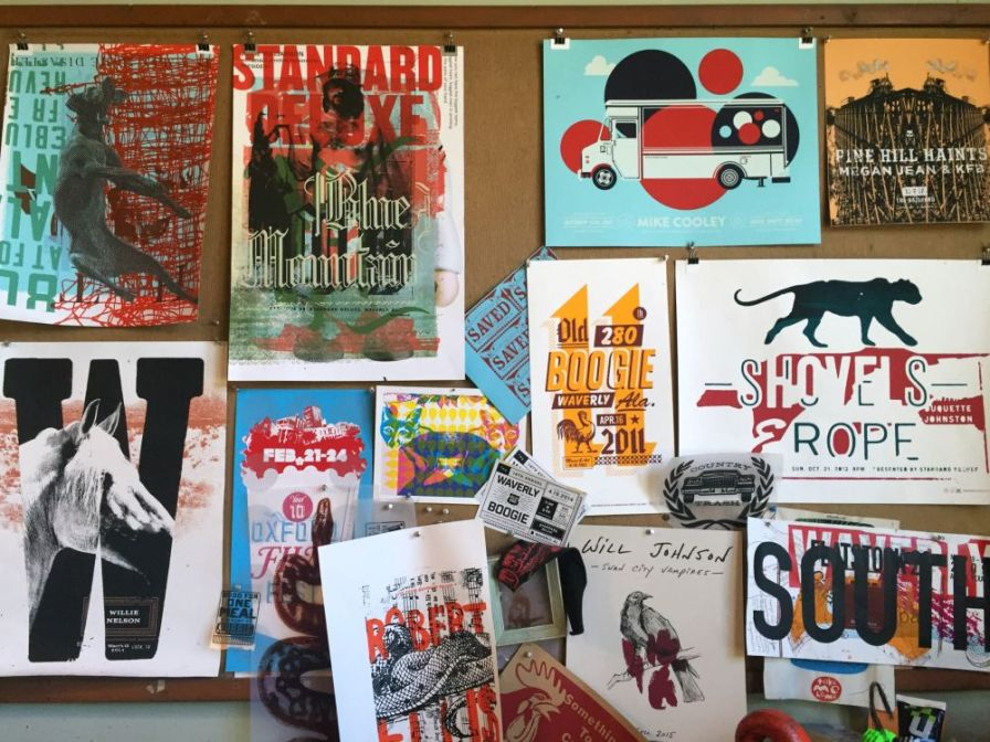 Wall of posters inside the shop.