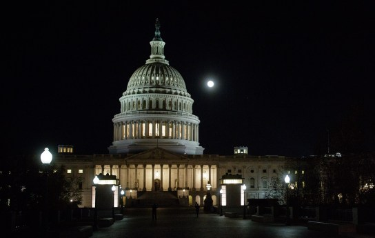 The moon, or supermoon, is seen as it sets behind the U.S. Capitol in Washington, D.C. (Joel Kowsky/NASA)