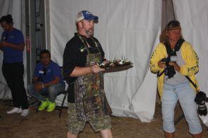 Flora-Bama Yacht Club's Chris Sherrill presents dish in seafood competititon. (Robert DeWitt/Alabama NewsCenter)