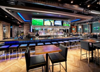 Birmingham officials are displaying a willingness to work with businesses that is paying off in announced developments such as Topgolf downtown. Pictured is the main bar of the Topgolf location in Dallas. (Michael Baxter/Baxter Imaging LLC)