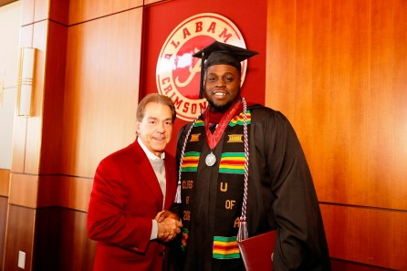 Nick Saban poses with Alphonse Taylor, one of more than 30 Crimson Tide student-athletes graduation from the University of Alabama Saturday. (Robert Sutton/UA Athletics)
