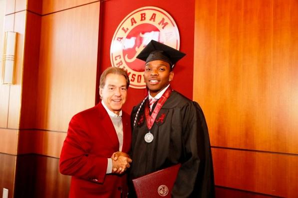 Nick Saban poses with Eddie Jackson, one of more than 30 Crimson Tide student-athletes graduation from the University of Alabama Saturday. (Robert Sutton/UA Athletics)